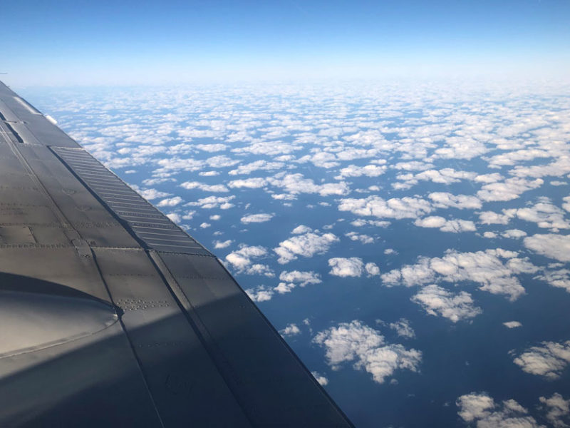 Shallow cumulus clouds characteristic of a cold air outbreak are seen from a NASA UC-12 King Air during a joint science flight on 1 March 2020. A NASA HU-25 Falcon was simultaneously conducting in situ measurements of those clouds. Data from the two aircraft will be used to improve forecasts of marine boundary layer clouds. Credit: Armin Sorooshian, University of Arizona. Used with permission.